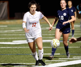 Lexi Zandonella chases down a ball on the soccer field