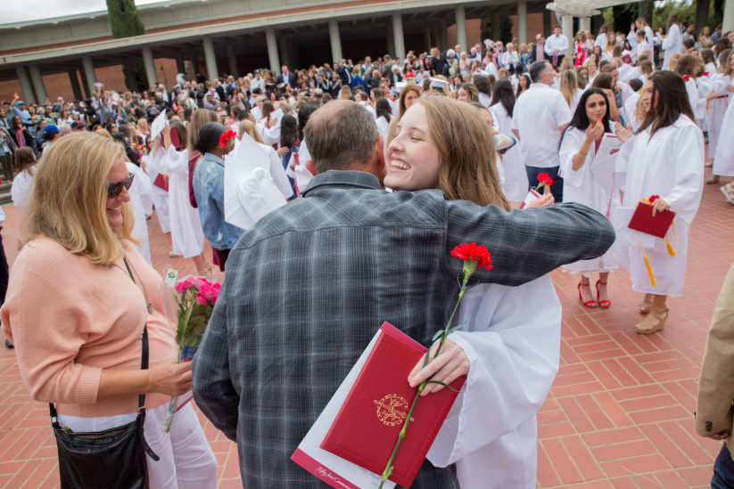 Big smiles and big hugs for this Class of 2019 grad and her father.